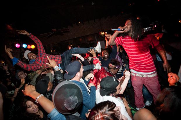 Fan crowd-surfs / Photo by Ryan Muir