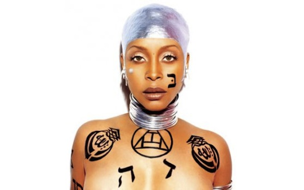 "The culprit photo of Erykah Badu, which depicts tattoos of multiple words for ""God"""