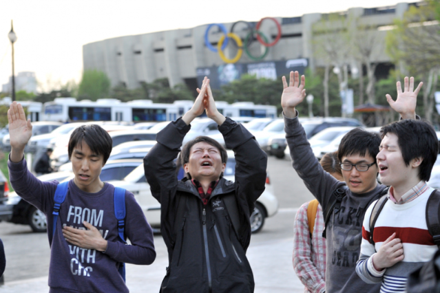 South Koreans protesting the arrival of Lady Gaga / Photo by Jung Yeon-Je/AFP/Getty