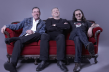 From left to right: Rush's Neil Peart, Alex Lifeson, and Geddy Lee / Photo by Andrew MacNaughtan