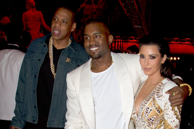 Jay-Z, Kanye West, and some lady / Photo by Marc Piasecki/Getty Images for Belvedere