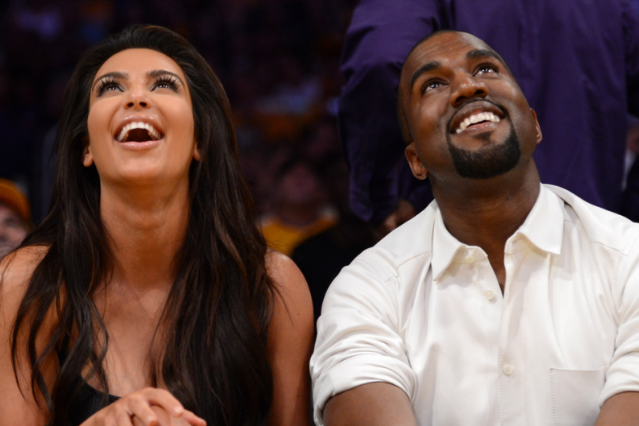 This is literally the only photo of Kanye West smiling on Getty Images / Photo by Harry How/Getty