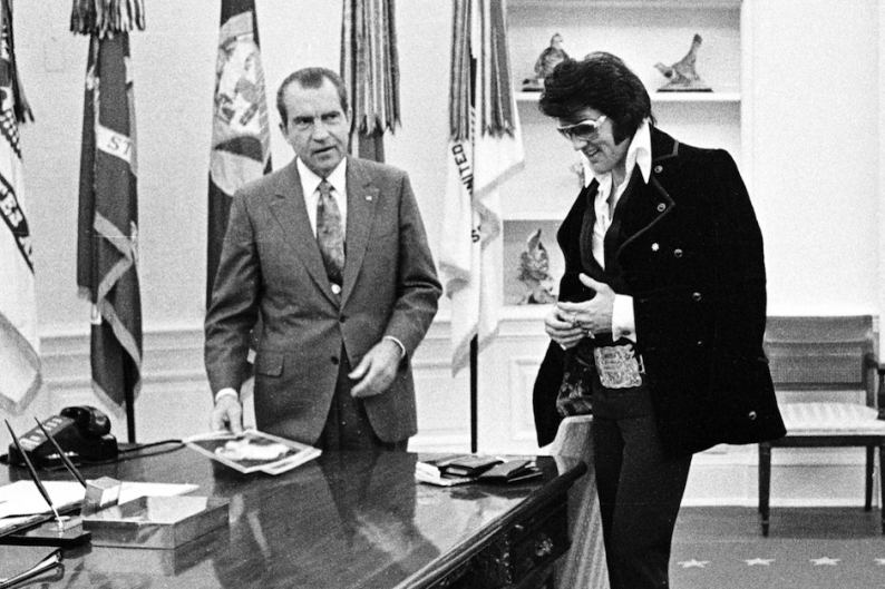 Richard Nixon and Elvis Presley / Photo by Getty Images