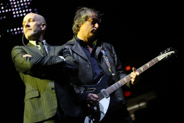 Peter Buck onstage with R.E.M. / Photo by Getty Images