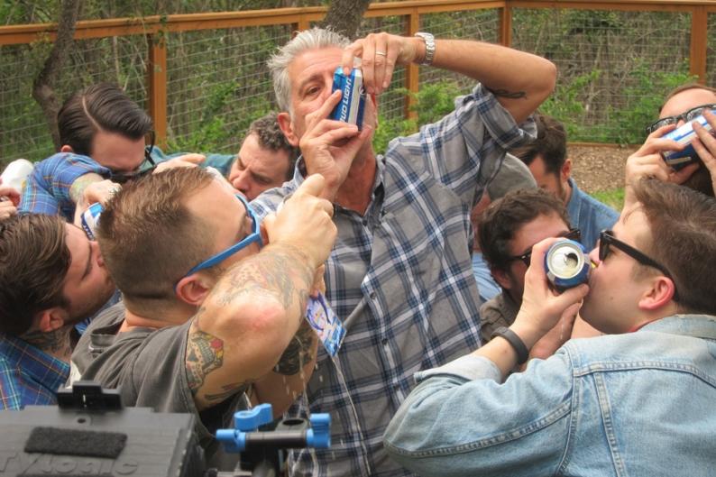Anthony Bourdain shotguns a beer with Derek Miller / Photo Courtesy of Travel Channel
