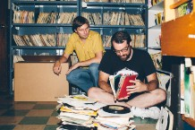 Ken Shipley (left) and Rob Sevier (right) dig through 45s at the Rock Shop. (Photo by Daymon Gardner)