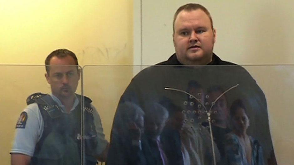 Megaupload founder Kim Dotcom (R), attending the North Shore court in Auckland on January 25 / AFP/Getty Images