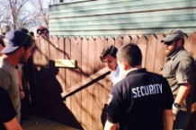 Security attempting to reinforce the gate at Tyler, the Creator's SXSW show at Scoot Inn