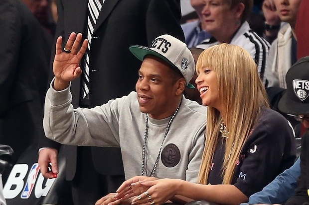 Jay-Z and Beyonce watch the Nets / Photo by Getty