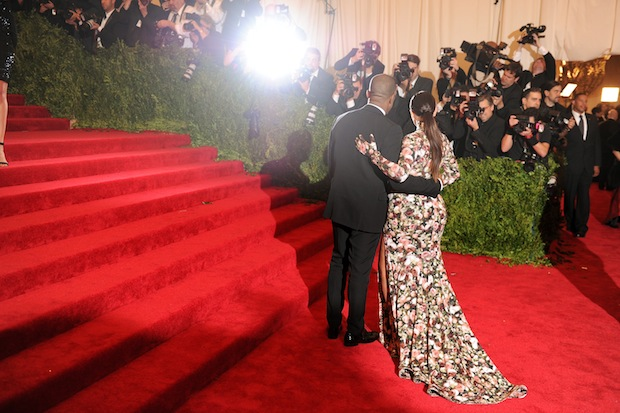 Kimye pose for the paps in happier times. / Photo by Getty Images