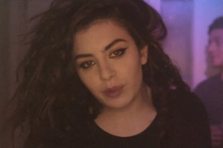 Charli XCX Woozily Wanders Through a Dingy Club in 'Take My Hand' Video