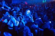 A masked Win Butler joins the crowd at 299 Meserole
