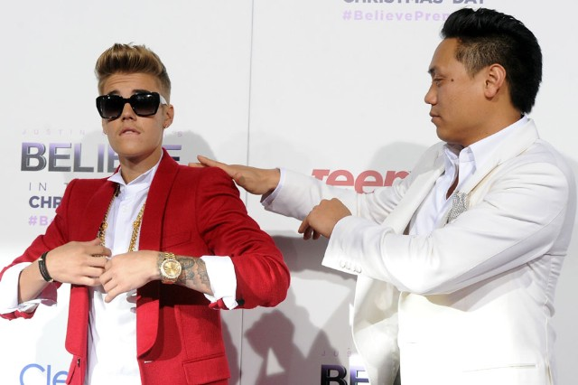 Director Jon Chu brushes that dirt off Biebs' shoulder