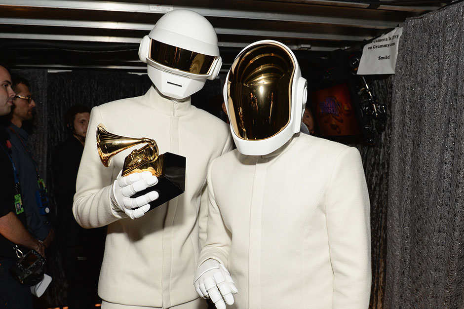Daft Punk holding their Grammy Award