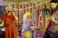 Tacocat Binge on Candy, Wear Papier-Mâché Heads in 'I Hate the Weekend' Video