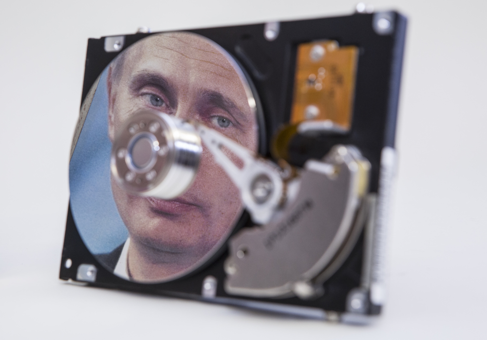 Putin-portrait reflected in a computer hard-drive.