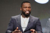 50 Cent Punches Female Fan at Concert While Being Pulled Into Crowd