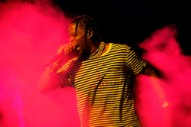 Watch Travis Scott Peer Pressure Fans Into Jumping Off Balcony at Terminal 5 Show