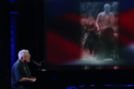 Watch Randy Newman Perform &#8220;Putin&#8221; in Front of Topless Putin Photos on <i>Colbert</i>
