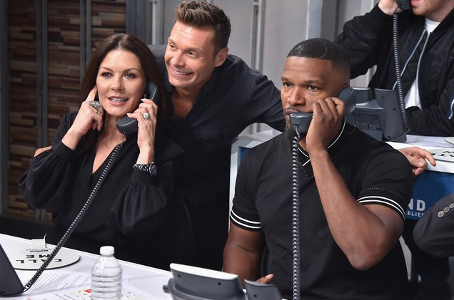 Catherine-Zeta-Jones-Ryan-Seacrest-Jamie-Fox-hand-in-hand-2017-billboard-1548-1505313425