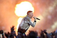 Watch Macklemore's Controversial Performance At National Rugby League Grand Final