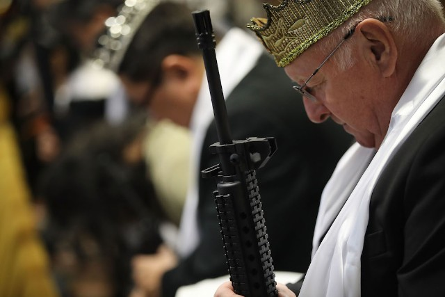 World Peace And Unification Sanctuary Religious Group Holds Blessing Ceremony For Couples And Their AR-15 Rifles