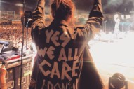 "Eddie Vedder's Wife Wears ""Yes We All Care. Y Don't U?"" Jacket at Pearl Jam Concert in Milan"
