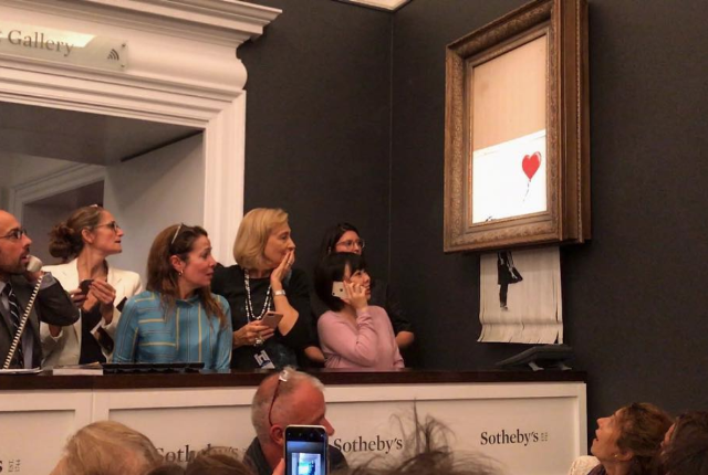 banksy-painting-self-destructs-moments-after-going-for-1-4-million-at-auction