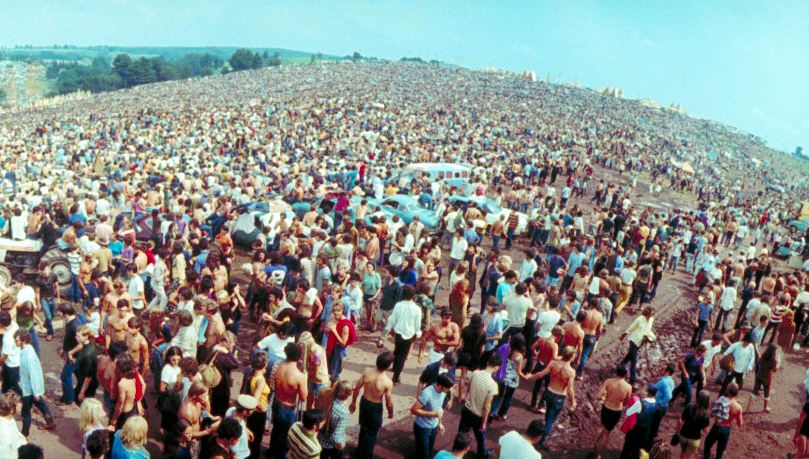 Wide-angle overall of huge crowd facing