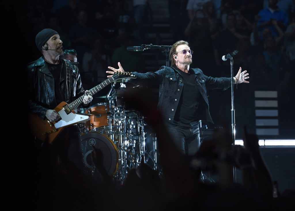 Watch Bono and the Edge Play Christmas Songs While Busking to Benefit the Homeless