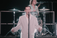 "Watch The 1975 Pay Tribute to Talking Heads in ""It's Not Living (If It's Not With You)"" Video"