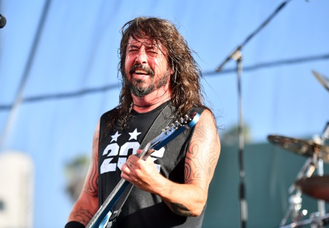 Dave Grohl chugs a beer… then falls off the stage