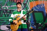 "Watch Vampire Weekend Cover <i>Parks and Rec</i> Theme, Play L'Homme Run's ""Pizza Party"""