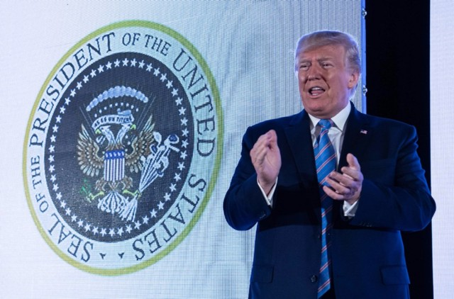 "Trump Gives Speech in Front of Presidential Seal Doctored to Say ""45 Is a Puppet"""