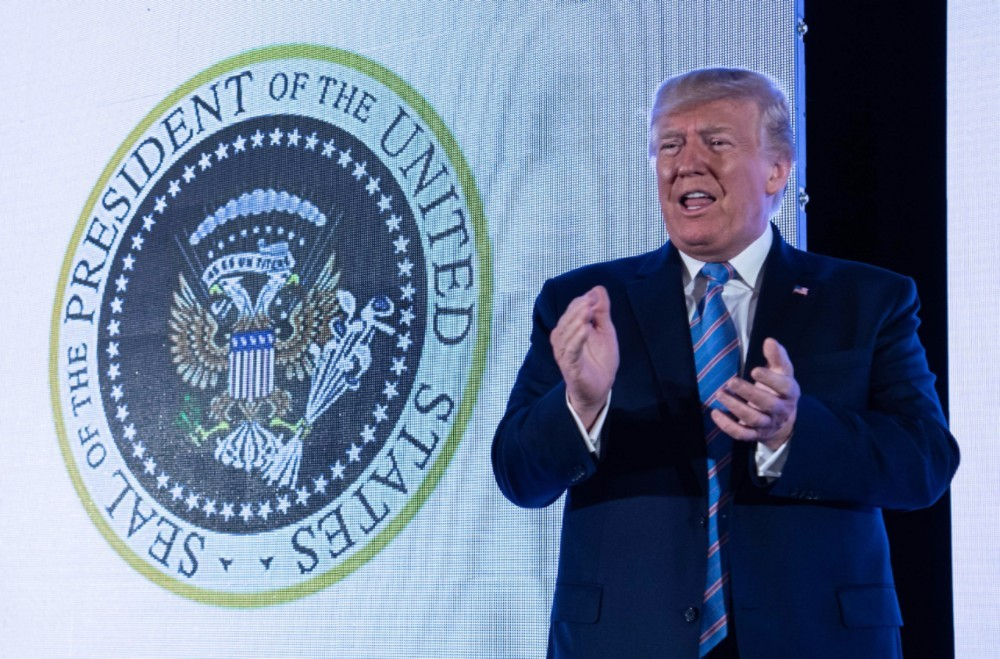 """Trump Gives Speech in Front of Presidential Seal Doctored to Say """"45 Is a Puppet"""""""