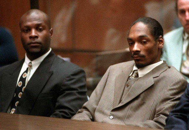 Rapper Snoop Doggy Dogg (R), whose real name is Cl