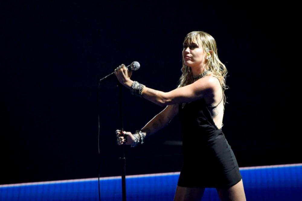 Miley Cyrus Gets Pixies Lyrics Tattooed on Her Bicep