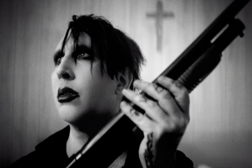 """Marilyn Manson Buries Himself in New """"God's Gonna Cut You Down"""" Video: Watch"""