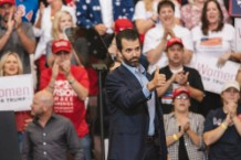 Donald Trump Jr. Poses With Assault Rifle with Hillary Clinton Behind Bars, Iron Cross
