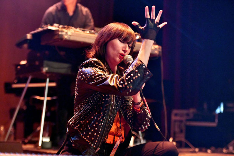 Karen O performing onstage