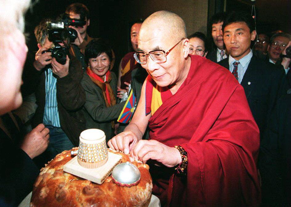 The spiritual leader of Tibet, the Dalai Lama, tri