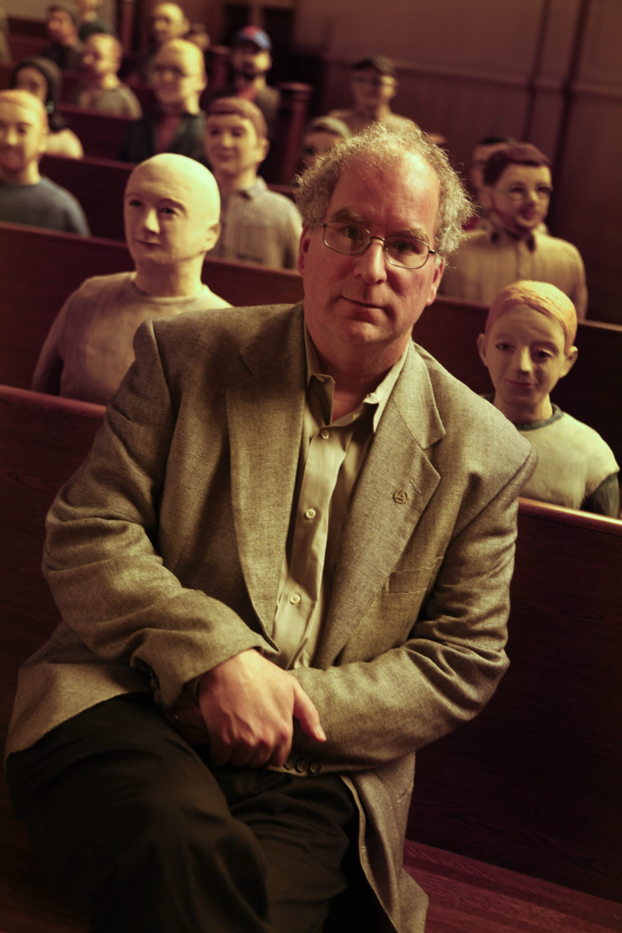 Brewster Kahle, sitting with some of the