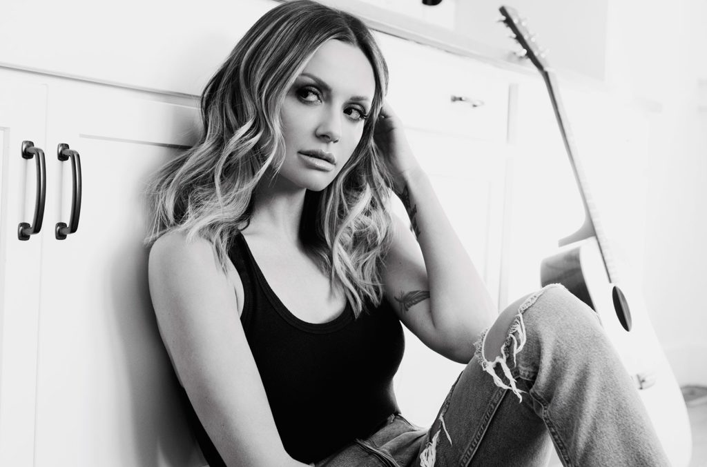 Carly Pearce sitting