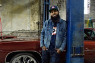 Stalley Rides Through Compton Streets in 'Jackin' Chevys' Video