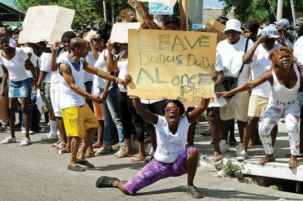 His supporters take to the streets / Photo by Ian Allen/The Jamaica Gleaner/AP Photo