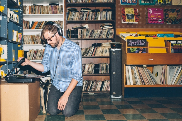 Dustin Drase listens to an album on his portable turntable at the Rock Shop. (Photo by Daymon Gardner)
