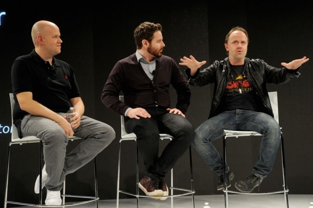 Spotify CEO Daniel Ek (L), Napster co-founder Sean Parker (C) and Metallica's Lars Ulrich attend the 2012 Spotify press event on December 6 in New York City / Kevin Mazur/WireImage