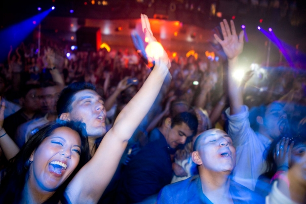 Club goers dance as DJ Sebastian Ingrosso spins at Light Nightclub in Las Vegas on July 5, 2013 / Photo by Leila Navidi