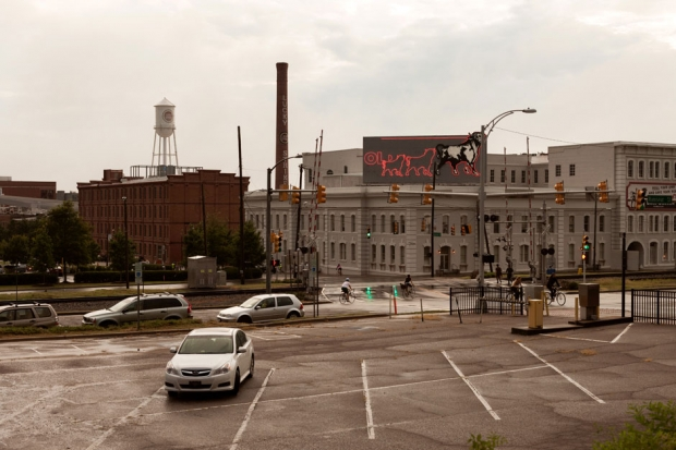 The Lucky Strike water tower and smokestack and Bull Durham Tobacco neon sign / Photo by Jeremy M. Lange