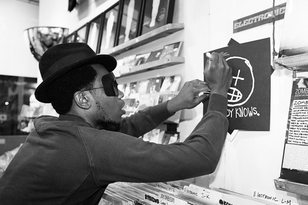 Willis Earl Beal signs a copy of Nobody Knows / Photo by Jordan Jablon for SPIN